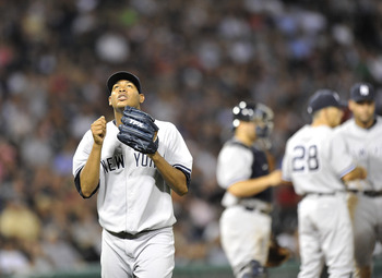 CHICAGO, IL - AUGUST 04:  Starting pitcher Ivan Nova #47 of the New York Yankees looks up to the sky after he was taken out of the game during the eight inning against the Chicago White Sox at U.S. Cellular Field on August 4, 2011 in Chicago, Illinois. Th