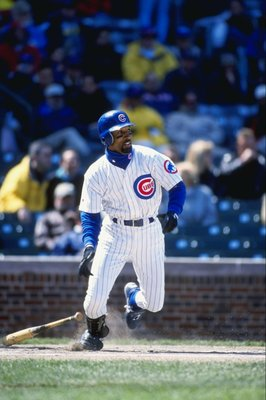 23 Apr 1999:  Lance Johnson #1 of the Chicago Cubs starts to run after hitting the ball during the game against the New York Mets at Wrigley Field in Chicago, Illinois. The Mets defeated the Cubs 6-5. Mandatory Credit: Jonathan Daniel  /Allsport