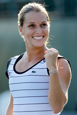 STANFORD, CA - JULY 29: Dominika Cibulkova of Slovakia celebrates match point against Marina Erakovic of New Zealand during the Bank of the West Classic at the Taube Family Tennis Stadium on July 29, 2011 in Stanford, California.  (Photo by Matthew Stockm
