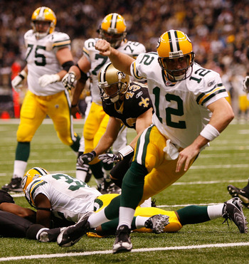 NEW ORLEANS - NOVEMBER 24:  Quarterback Aaron Rodgers #12 of the Green Bay Packers celebrates after scoring a touchdown in the second quarter against the New Orleans Saints on November 24, 2009 at the Superdome in New Orleans, Louisiana.  (Photo by Chris
