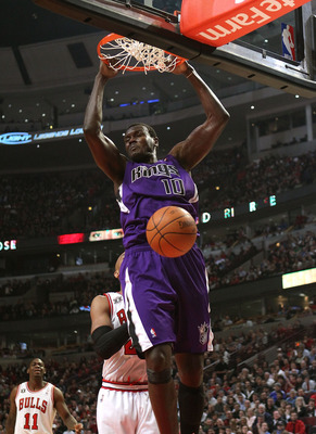 CHICAGO, IL - MARCH 21: Samuel Dalembert #10 of the Sacramento Kings dunks the ball against the Chicago Bulls at the United Center on March 21, 2011 in Chicago, Illinois. NOTE TO USER: User expressly acknowledges and agrees that, by downloading and/or usi