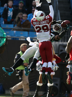 CHARLOTTE, NC - DECEMBER 19:  Dominique Rodgers-Cromartie #29 of the Arizona Cardinals breaks up a pass to Steve Smith #89 of the Carolina Panthers during their game at Bank of America Stadium on December 19, 2010 in Charlotte, North Carolina.  (Photo by