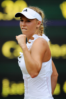 LONDON, ENGLAND - JUNE 25:  Caroline Wozniacki of Denmark reacts to a play during her third round match against Jarmila Gajdosova of Australia on Day Six of the Wimbledon Lawn Tennis Championships at the All England Lawn Tennis and Croquet Club on June 25