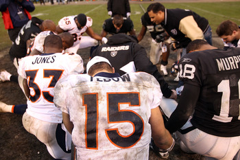 OAKLAND, CA - DECEMBER 19:  Tim Tebow #15 of the Denver Broncos prayers with a group of players after their game against the Oakland Raiders at Oakland-Alameda County Coliseum on December 19, 2010 in Oakland, California.  (Photo by Ezra Shaw/Getty Images)