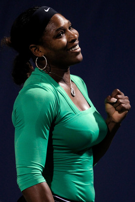 STANFORD, CA - JULY 29:  Serena Williams celebrates match point against Maria Sharapova of Russia during the Bank of the West Classic at the Taube Family Tennis Stadium on July 29, 2011 in Stanford, California.  (Photo by Matthew Stockman/Getty Images)