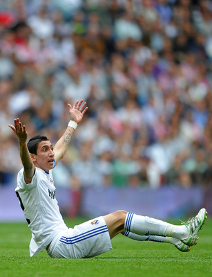 MADRID, SPAIN - APRIL 02:  Angel Di Maria of Real Madrid reacts during the la Liga match between Real Madrid and Sporting Gijon  at Estadio Santiago Bernabeu on April 2, 2011 in Madrid, Spain.  (Photo by Jasper Juinen/Getty Images)