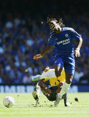 CARDIFF, UNITED KINGDOM - AUGUST 07:  Ashley Cole of Arsenal tackles and fouls Didier Drogba of Chelsea during the FA Community Shield match between Arsenal and Chelsea at The Millennium Stadium on August 7, 2005 in Cardiff, Wales.  (Photo by Mike Hewitt/