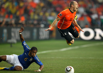 PORT ELIZABETH, SOUTH AFRICA - JULY 02:  Arjen Robben of The Netherlands dives over the tackle of Michel Bastos of Brazil during the 2010 FIFA World Cup South Africa Quarter Final match between Netherlands and Brazil at Nelson Mandela Bay Stadium on July