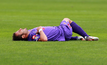FLORENCE, ITALY - SEPTEMBER 26:  Alberto Gilardino of ACF Fiorentina injured during the Serie A match between ACF Fiorentina and Parma FC at Stadio Artemio Franchi on September 26, 2010 in Florence, Italy.  (Photo by Paolo Bruno/Getty Images)