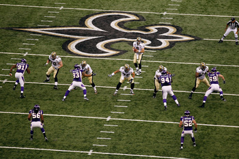 NEW ORLEANS - SEPTEMBER 09:  Quarterback Drew Brees #9 of the New Orleans Saints drops back to pass against the Minnesota Vikings at Louisiana Superdome on September 9, 2010 in New Orleans, Louisiana.  (Photo by Chris Graythen/Getty Images)