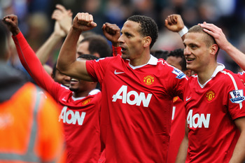 BLACKBURN, ENGLAND - MAY 14:  Rio Ferdinand and Nemanja Vidic of Manchester United celebrate after drawing the Barclays Premier League match between Blackburn Rovers and Manchester United but winning the title at Ewood park on May 14, 2011 in Blackburn, E