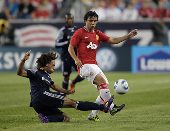 FOXBORO, MA - JULY 13:  Fabio #20 of the Manchester United presses Kevin Alston #30 of the New England Revolution during a friendly match at Gillette Stadium on July 13, 2011 in Foxboro, Massachusetts. (Photo by Jim Rogash/Getty Images)