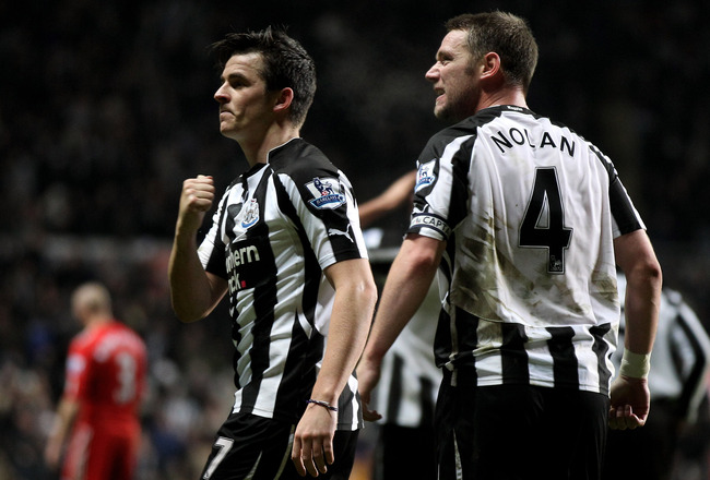 NEWCASTLE UPON TYNE, ENGLAND - DECEMBER 11:  Joey Barton of Newcastle United celebrates scoring his team's second goal with team mate Kevin Nolan (R) during the Barclays Premier League match between Newcastle United and Liverpool at St James' Park on Dece