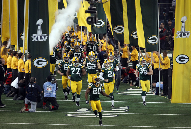 ARLINGTON, TX - FEBRUARY 06:  Atari Bigby #20 of the Green Bay Packers leads the Packers onto the field to take on the Pittsburgh Steelers before Super Bowl XLV at Cowboys Stadium on February 6, 2011 in Arlington, Texas.  (Photo by Jonathan Daniel/Getty I