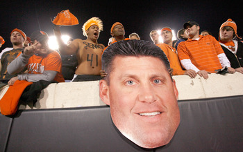 STILLWATER, OK - NOVEMBER 27:  Oklahoma State Cowboy fans cheer with a cardboard cutout of Oklahoma State head coach Mike Gundy as the Cowboys prepare to take on the Oklahoma Soones at Boone Pickens Stadium on November 27, 2010 in Stillwater, Oklahoma.  (