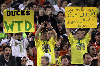 GLENDALE, AZ - JANUARY 10:  Oregon Ducks' fans hold up signs during the Tostitos BCS National Championship Game at University of Phoenix Stadium on January 10, 2011 in Glendale, Arizona.  (Photo by Ronald Martinez/Getty Images)
