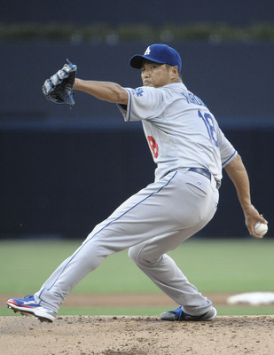 SAN DIEGO, CA - AUGUST 2:  Hiroki Kuroda #18 of the Los Angeles Dodgers pitches during the first inning of a baseball game against the San Diego Padres at Petco Park on August 2, 2011 in San Diego, California.  The Dodgers won 1-0.  (Photo by Denis Poroy/