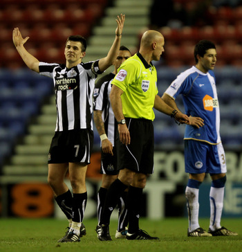 WIGAN, ENGLAND - JANUARY 02:  Joey Barton of Newcastle United reacts prior to being booked during the Barclays Premier League match between Wigan Athletic and Newcastle United at the DW Stadium on January 2, 2011 in Wigan, England.  (Photo by Clive Brunsk