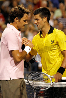 TORONTO, ON - AUGUST 14:  Roger Federer of Switzerland is congratulated at the net by Novak Djokovic of Serbia after their match during the semifinals of the Rogers Cup at the Rexall Centre on August 14, 2010 in Toronto, Canada.  (Photo by Matthew Stockma