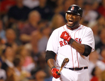 BOSTON, MA - AUGUST 2:  David Ortiz #34 of the Boston Red Sox reacts after missing on a swing against the Cleveland Indians at Fenway Park on August 2, 2011 in Boston, Massachusetts.  (Photo by Jim Rogash/Getty Images)