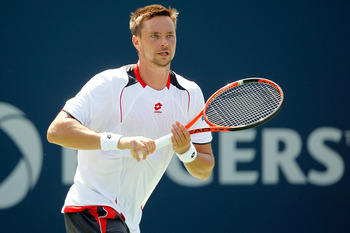 TORONTO, ON - AUGUST 12:  Robin Soderling of Sweden returns a shot to David Nalbandian of Argentina during the Rogers Cup at the Rexall Centre on August 12, 2010 in Toronto, Canada.  (Photo by Matthew Stockman/Getty Images)