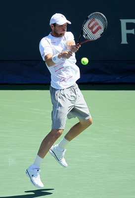 LOS ANGELES, CA - JULY 31:  Mardy Fish hits a return to Ernests Gulbis of Latvia  in the singles final of the Farmers Classic presented by Mercedes-Benz at the LA Tennis Center on July 31, 2011 in Los Angeles, California.   Gulbis won 5-7, 6-4, 6-4.  (Pho