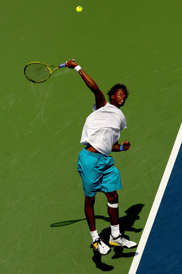 MONTREAL, QC - AUGUST 12:  Gael Monfils of France serves to Juan Carlos Ferrero of Spain during the Rogers Cup at Uniprix Stadium on August 12, 2009 in Montreal, Canada.  (Photo by Matthew Stockman/Getty Images)