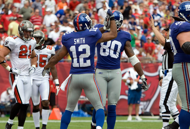 TAMPA, FL - SEPTEMBER 27:  Receivers Steve Smith #12 and Derek Hagan #80 of the New York Giants celebrate a touchdown against the Tampa Bay Buccaneers during the game at Raymond James Stadium on September 27, 2009 in Tampa, Florida.  (Photo by J. Meric/Ge