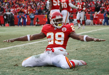 KANSAS CITY, MO - JANUARY 09:  Safety Eric Berry #29 of the Kansas City Chiefs celebrates after breaking up a pass to tight end Todd Heap #86 of the Baltimore Ravens in the endzone during their 2011 AFC wild card playoff game at Arrowhead Stadium on Janua