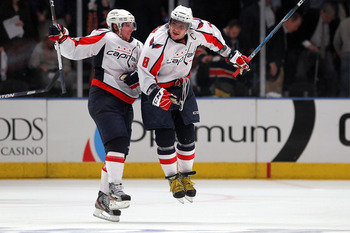 NEW YORK, NY - APRIL 20:  (L-R) Nicklas Backstrom #19 and Alex Ovechkin #8 of the Washington Capitals celebrate after they won 4-3 in the second overtime against the New York Rangers in Game Four of the Eastern Conference Quarterfinals during the 2011 NHL