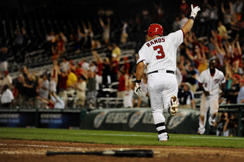 WASHINGTON, DC - JUNE 21: Wilson Ramos #3 of the Washington Nationals celebrates his three run home run in the bottom of the ninth inning to defeat the Seattle Mariners at Nationals Park on June 21, 2011 in Washington, DC. Washington Nationals won, 6-5, o