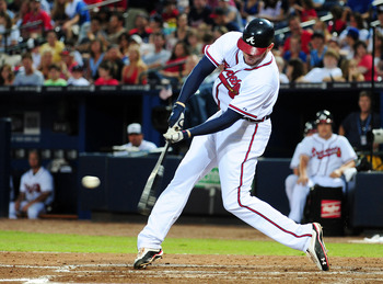 ATLANTA - JULY 4: Freddie Freeman #5 of the Atlanta Braves hits a home run against the Colorado Rockies at Turner Field on July 4, 2011 in Atlanta, Georgia. (Photo by Scott Cunningham/Getty Images)
