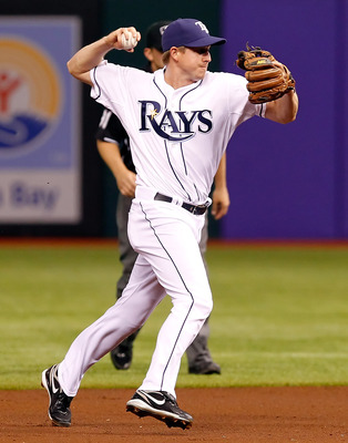 ST. PETERSBURG, FL - APRIL 18:  Infielder Elliot Johnson #9 of the Tampa Bay Rays throws over to first for an out against the Chicago White Sox during the game at Tropicana Field on April 18, 2011 in St. Petersburg, Florida.  (Photo by J. Meric/Getty Imag