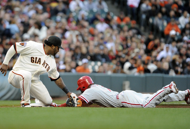 SAN FRANCISCO, CA - AUGUST 4: Jimmy Rollins #11 of the Philadelphia Phillies attempting to steal third is tagged out by Pablo Sandoval #48 of the San Francisco Giants in the first inning during a MLB baseball game at AT&T Park August 4, 2011 in San Franci