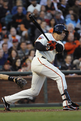 SAN FRANCISCO, CA - AUGUST 1: Carlos Beltran #15 of the San Francisco Giants gets a base-hit against the Arizona Diamondbacks in the fourth inning during a MLB baseball game at AT&T Park August 1, 2011 in San Francisco, California. (Photo by Thearon W. He