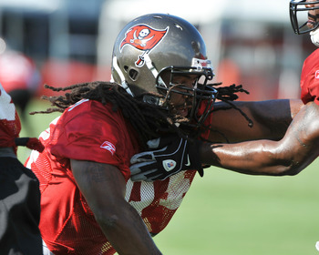 TAMPA, FL - JULY 29:  Defensive end Adrian Clayborn #94 of the Tampa Bay Buccaneers practices during the team's first pre-season training camp practice July 29, 2011 at One Buccaneer Place in Tampa, Florida. (Photo by Al Messerschmidt/Getty Images)