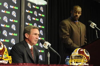 ASHURN, VA - APRIL 6:  Mike Shanahan, head coach of the Washington Redskins, answers questions during a press conference introducing Donovan McNabb to the media on April 6, 2010 at Redskin Park in Ashburn, Virginia.  (Photo by Mitchell Layton/Getty Images