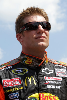 INDIANAPOLIS, IN - JULY 31:  Jamie McMurray, driver of the #1 Bass Pro Shops/Tracker Chevrolet, stands on the grid prior to the start of the NASCAR Sprint Cup Series Brickyard 400 at Indianapolis Motor Speedway on July 31, 2011 in Indianapolis, Indiana.