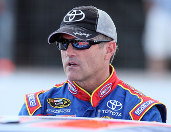 LOUDON, NH - JULY 15:  Bobby Labonte, driver of the #47 CapitalWindow/CapWinFund.com Toyota, stands on the grid during qualifying for the NASCAR Sprint Cup Series LENOX Industrial Tools 301 at New Hampshire Motor Speedway on July 15, 2011 in Loudon, New H