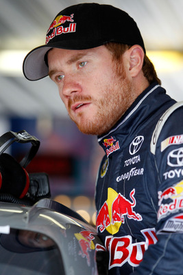 LONG POND, PA - AUGUST 05:  Brian Vickers, driver of the #83 Red Bull Toyota, prepares to practice for the NASCAR Sprint Cup Series Good Sam RV Insurance 500 at Pocono Raceway on August 5, 2011 in Long Pond, Pennsylvania.  (Photo by Todd Warshaw/Getty Ima