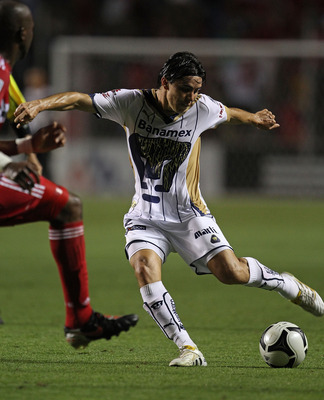 BRIDGEVIEW, IL - JULY 20: Efrain Velarde #2 of Pumas UNAM fires a shot against the Chicago Fire during a SuperLiga 2010 match at Toyota Park on July 20, 2010 in Bridgeview, Illinois. The Fire defeated Pumas UNAM 1-0. (Photo by Jonathan Daniel/Getty Images