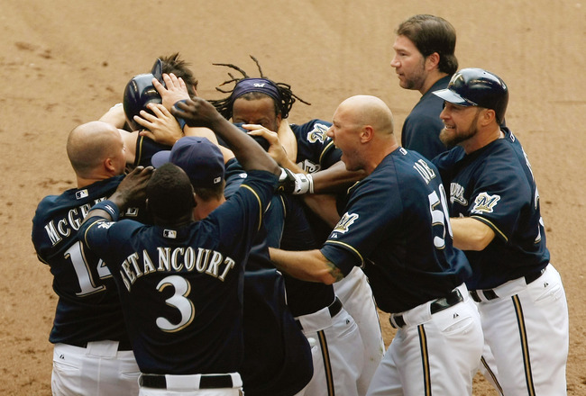 MILWAUKEE, WI - JULY 10: Milwaukee Brewers players celebrate after winning the game in the bottom of the 9th inning  against the Cincinnati Reds at Miller Park on July 10, 2011 in Milwaukee, Wisconsin. The Brewers defeated the Reds 4-3. (Photo by Scott Bo