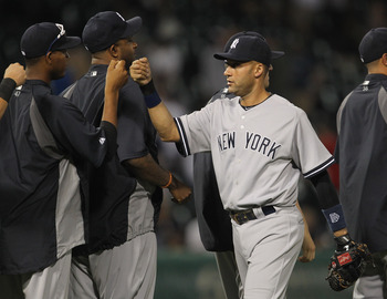CHICAGO, IL - AUGUST 03: Derek Jeter #2 of the New York Yankees celebrates a win with teammates over the Chicago White Sox at U.S. Cellular Field on August 3, 2011 in Chicago, Illinois. The Yankees defeated the White Sox 18-7. (Photo by Jonathan Daniel/Ge
