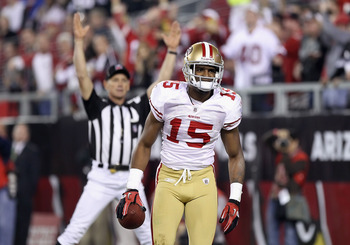 GLENDALE, AZ - NOVEMBER 29:  Wide receiver Michael Crabtree #15 of the San Francisco 49ers scores a 38 yard touchdown reception against the Arizona Cardinals during the first quarter of the NFL game at the University of Phoenix Stadium on November 29, 201
