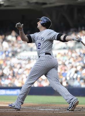 SAN DIEGO, CA - JULY 30: Troy Tulowitzki #2 of the Colorado Rockies hits a two-run homer during the first inning of a baseball game against the San Diego Padres at Petco Park on July 30, 2011 in San Diego, California.  (Photo by Denis Poroy/Getty Images)