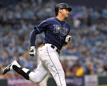 ST. PETERSBURG, FL - AUGUST 4:  Infielder Evan Longoria #3 of the Tampa Bay Rays homers in the fifth inning against the Toronto Blue Jays August 4, 2011 at Tropicana Field in St. Petersburg, Florida. (Photo by Al Messerschmidt/Getty Images)
