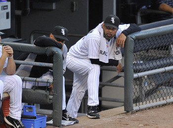 CHICAGO, IL - AUGUST 04:  Manager Ozzie Guillen #13 (R) of the Chicago White Sox and bench coach Joey Cora #28 stand in the dugout during the second inning at U.S. Cellular Field on August 4, 2011 in Chicago, Illinois.  (Photo by Brian Kersey/Getty Images