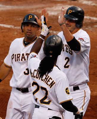 PITTSBURGH - AUGUST 04:  Andrew McCutchen #22 of the Pittsburgh Pirates congratulates teammates Xavier Paul #38 and Brandon Wood #2 after they scored against the Chicago Cubs in the fourth inning during the game on August 4, 2011 at PNC Park in Pittsburgh
