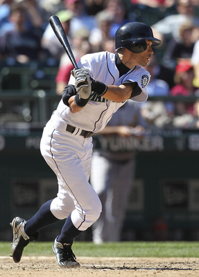 SEATTLE - AUGUST 03:  Ichiro Suzuki #51 of the Seattle Mariners singles in the eighth inning against the Oakland Athletics at Safeco Field on August 3, 2011 in Seattle, Washington. (Photo by Otto Greule Jr/Getty Images)
