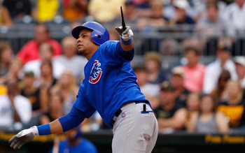 PITTSBURGH - AUGUST 02:  Aramis Ramirez #16 of the Chicago Cubs hits a broken bat RBI single against the Pittsburgh Pirates during the game on August 2, 2011 at PNC Park in Pittsburgh, Pennsylvania.  (Photo by Jared Wickerham/Getty Images)